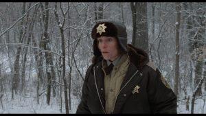 """Frances McDormand policininkės vaidmenyje garsiajame Joelio ir Ethano Coenų """"Fargo""""."""