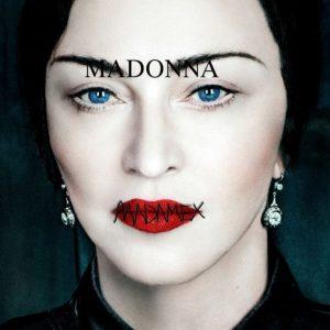 """Albumo """"Madame X"""" viršelis, vizualiniame lygmenyje ryškinantis Madonnos dvasinę giminystę su meksikiečių dailininke Frida Kahlo (1907-1954). Užsiūtos lūpos - nuoroda į draudimą kalbėti/dainuoti."""